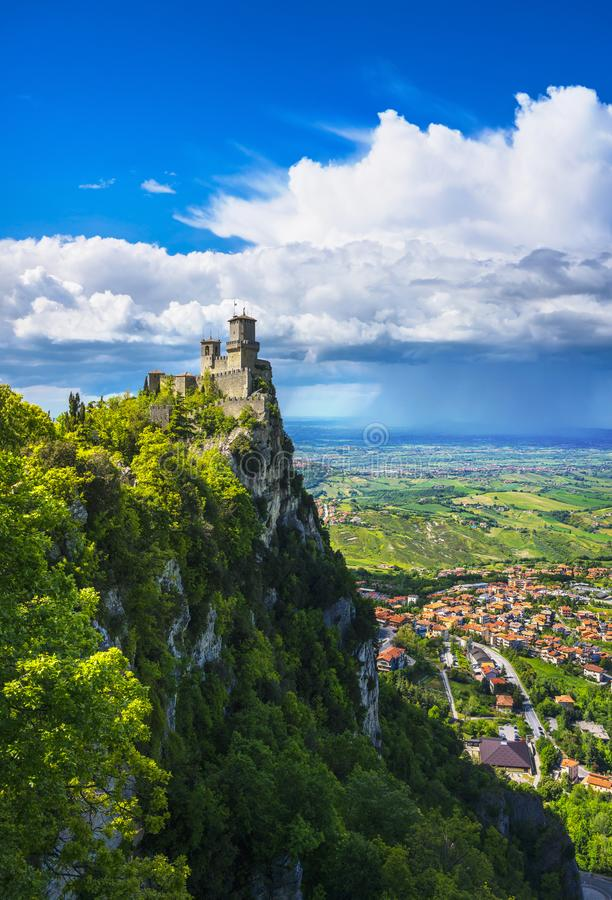 San Marino, medieval tower on a rocky cliff and panoramic view of Romagna. San Marino Republic, medieval Guaita first tower on a rocky cliff and panoramic view stock image