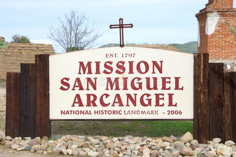 Close up on Mission San Miguel Arcangel sign. San Miguel, CA - January 13, 2019: Sign on side of road for Mission San Miguel Arcangel, a Spanish mission royalty free stock photography