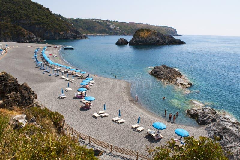 San Nicola Arcella, Cosenza, Calabria, southern Italy, Italy, Europe. Calabria, Italy, 26/06/2017: the black beach of Scoglio dello Scorzone, Scorzone`s Rock royalty free stock photo