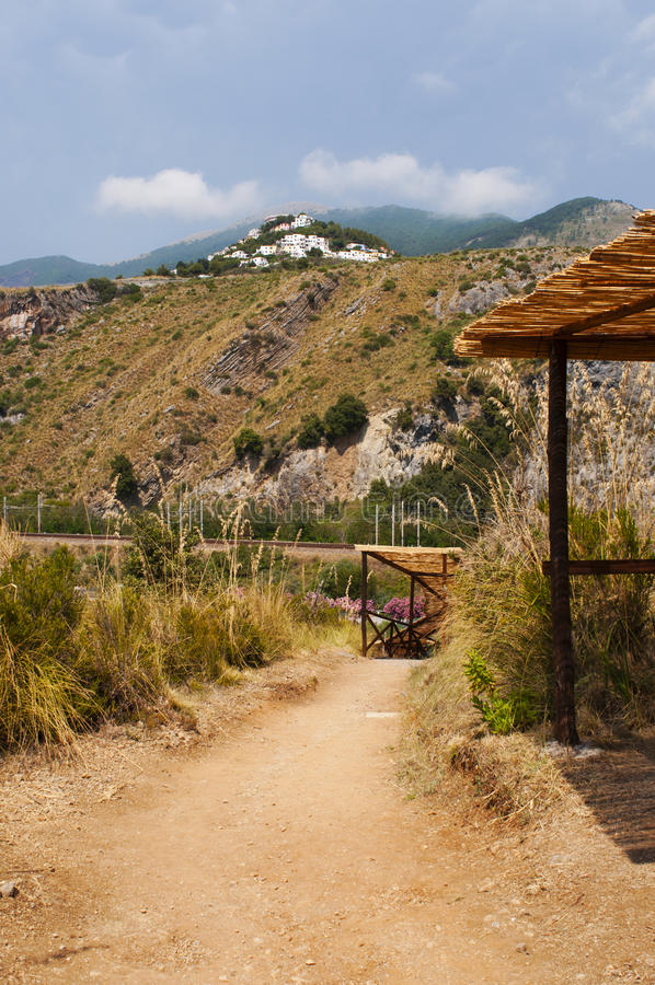 San Nicola Arcella, Cosenza, Calabria, southern Italy, Italy, Europe. Calabria, 26/06/2017: a sunny day of summer on the footpath which leads to the Arco Magno royalty free stock photography