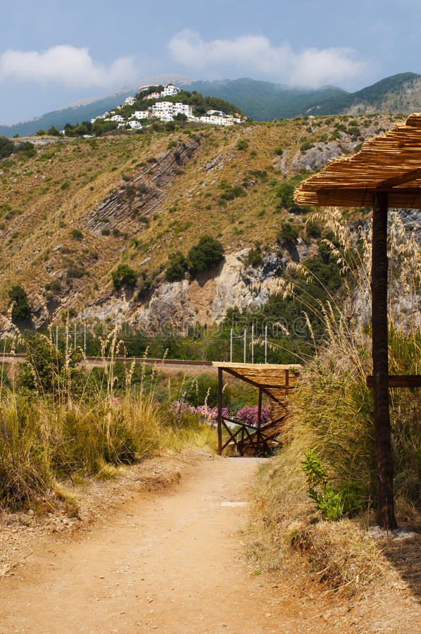San Nicola Arcella, Cosenza, Calabria, southern Italy, Italy, Europe. Calabria, 26/06/2017: a sunny day of summer on the footpath which leads to the Arco Magno royalty free stock image