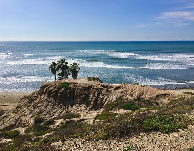San Onofre point California. Palm trees perched up on the bluffs along the Southern California coastline of San Onofre point stock photo
