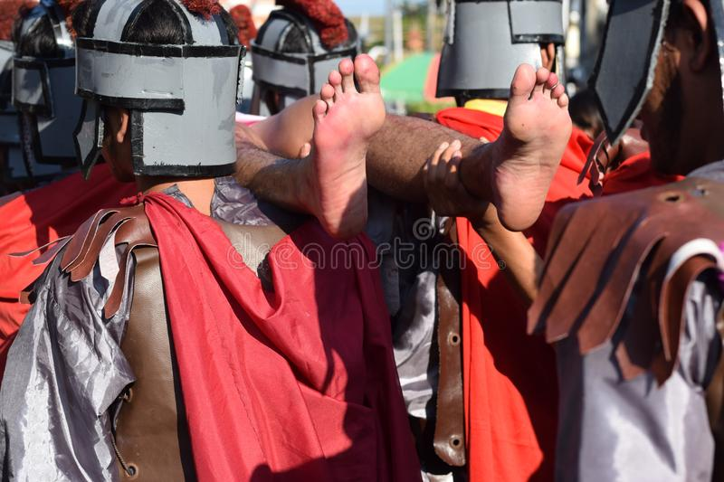 Foot of Jesus Christ`s corpse carried by roman soldiers, street drama, community celebrates Good Friday representing the events th. San Pablo City, Laguna royalty free stock image