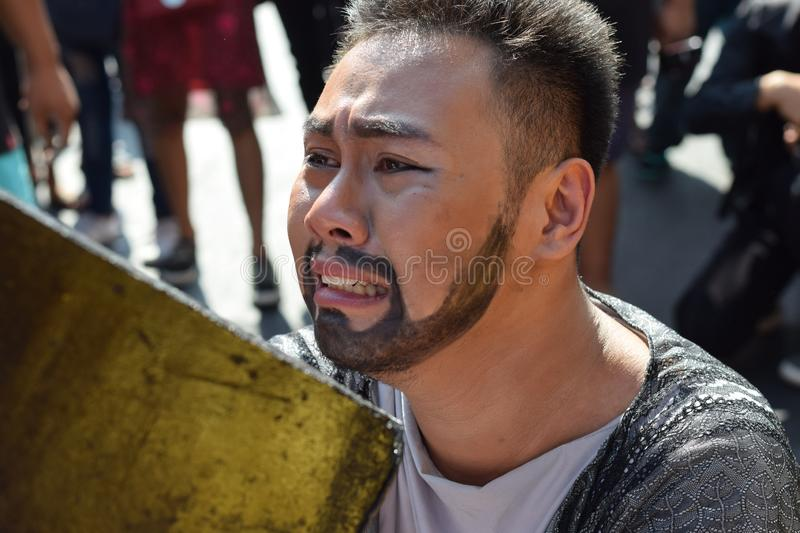 Real tears emit from the eyes of Judas Iscariot feeling pity to Jesus Christ, street drama, community celebrates Good Friday repr royalty free stock image