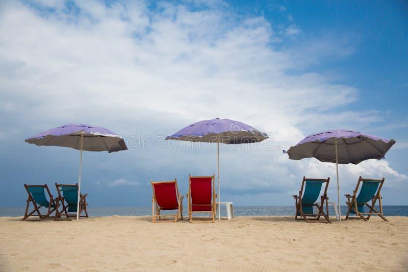 San pancho chairs and beach umbrellas. Beach chairs and umbrellas ready to go at San Panch Beach in San Francisco, Nayarit, Mexico royalty free stock images