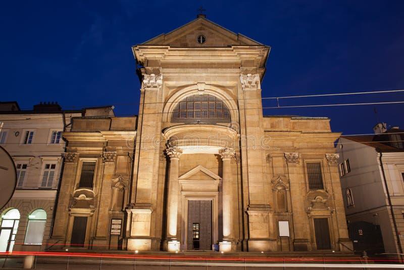 San Paul Conversion Church di notte a Cracovia immagine stock libera da diritti