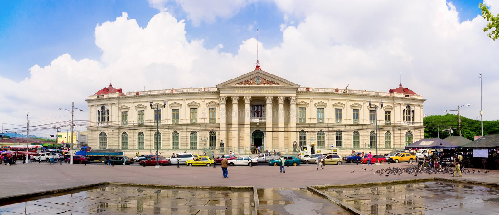 San Salvador, El Salvador - Presidential Palace. San Salvador, El Salvador - May-04-2014 Front view of the Presidential Palace with traffic jam royalty free stock photo