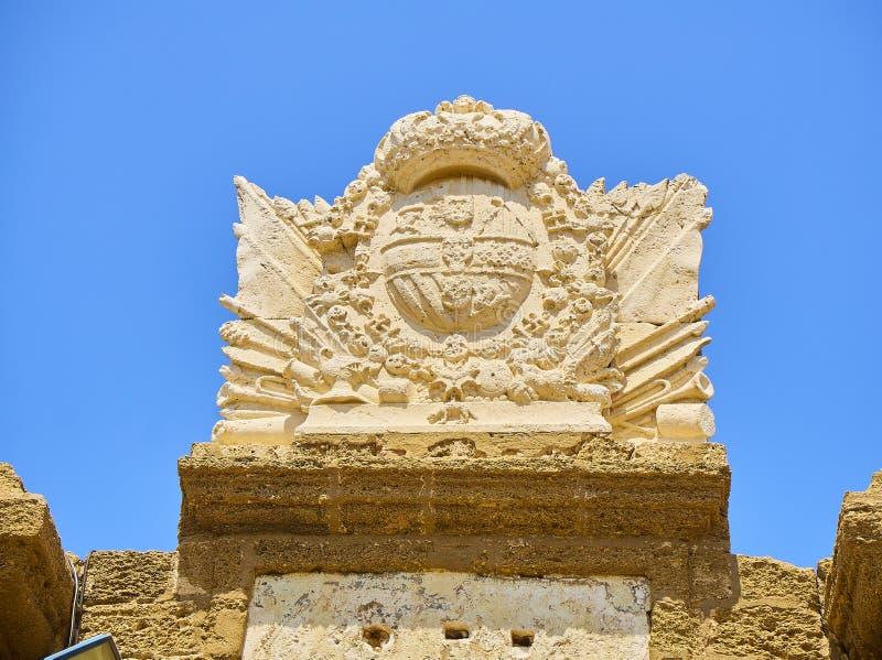San Sebastian Castle, a fortress in La Caleta island. Cadiz, Spain. Blazon of San Sebastian Castle, the ancient Phoenician Temple to Moloch / Kronos. detail stock image
