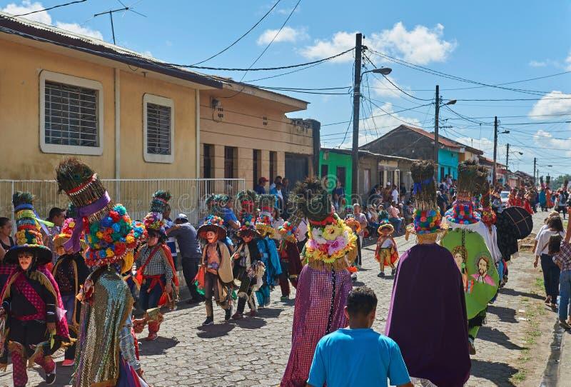 San Sebastian celebration dancing. Diriamba, Nicaragua - January 4, 2017: San Sebastian celebration dancing of people dressed in national clothes stock photo
