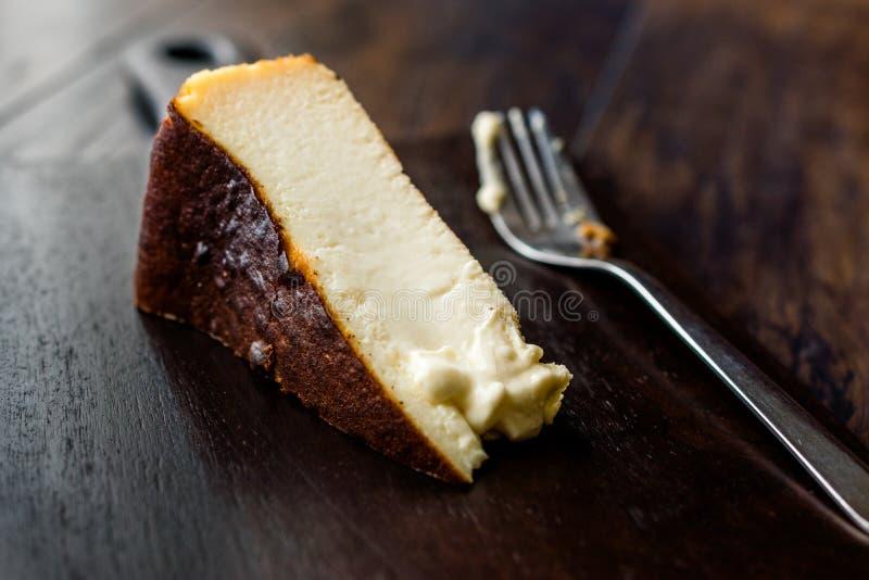 San Sebastian Cheesecake on wooden surface / Creamy Plain New York Style. Organic Dessert stock images