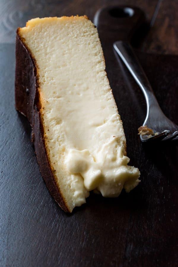 San Sebastian Cheesecake on wooden surface / Creamy Plain New York Style. Organic Dessert stock photography
