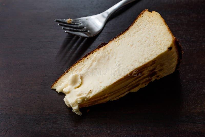 San Sebastian Cheesecake on wooden surface / Creamy Plain New York Style. Organic Dessert stock photos
