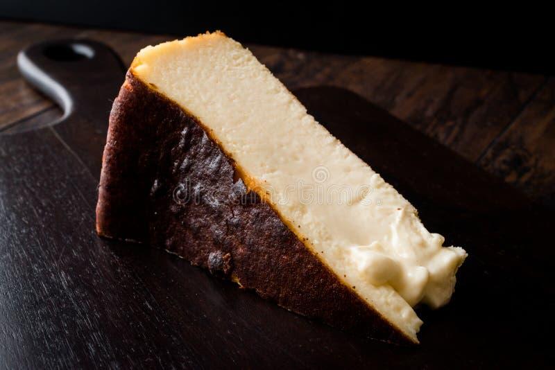 San Sebastian Cheesecake on wooden surface / Creamy Plain New York Style. Organic Dessert stock image