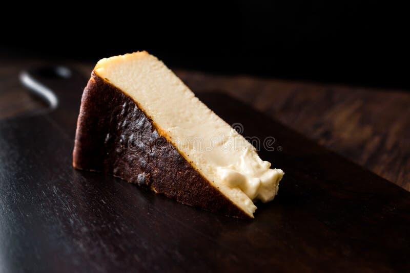 San Sebastian Cheesecake on wooden surface / Creamy Plain New York Style. Organic Dessert stock photo