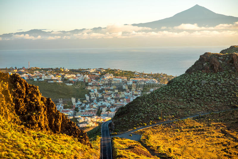 San Sebastian city on La Gomera island. Landscape view on mountain road and San Sebastian city with Tenerife island on the background in the morning royalty free stock images