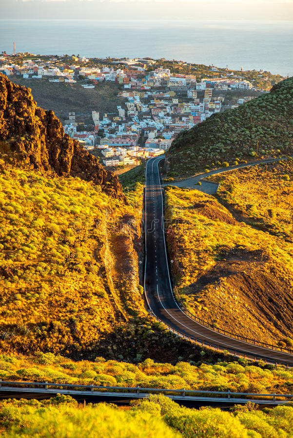 San Sebastian city on La Gomera island. Landscape view on mountain road and San Sebastian city with Tenerife island on the background in the morning stock photos