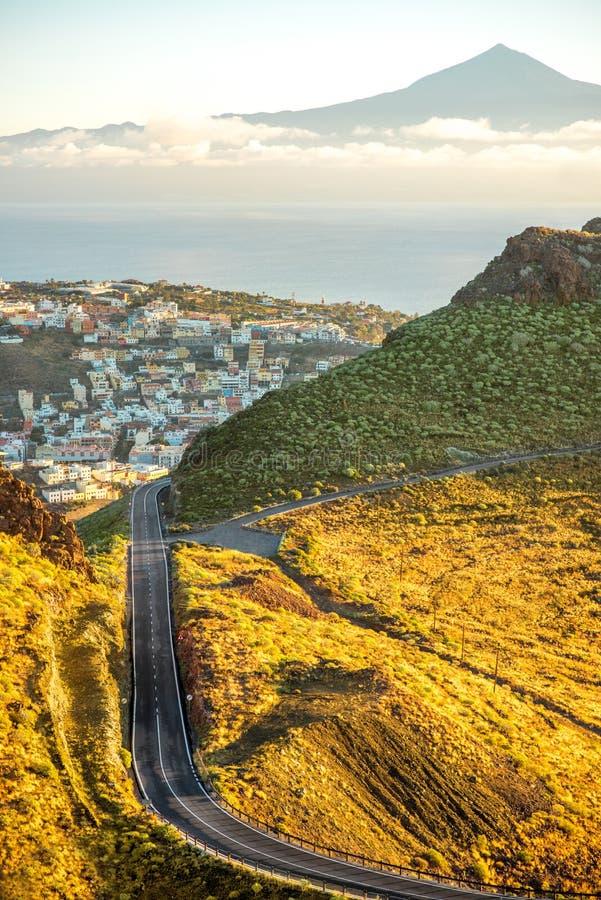 San Sebastian city on La Gomera island. Landscape view on mountain road and San Sebastian city with Tenerife island on the background in the morning royalty free stock photo