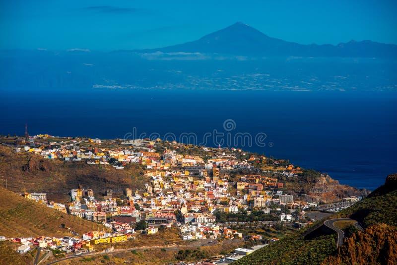San Sebastian city on La Gomera island. Top view on San Sebastian city the capital of La Gomera island with Teide volcano on the background royalty free stock images