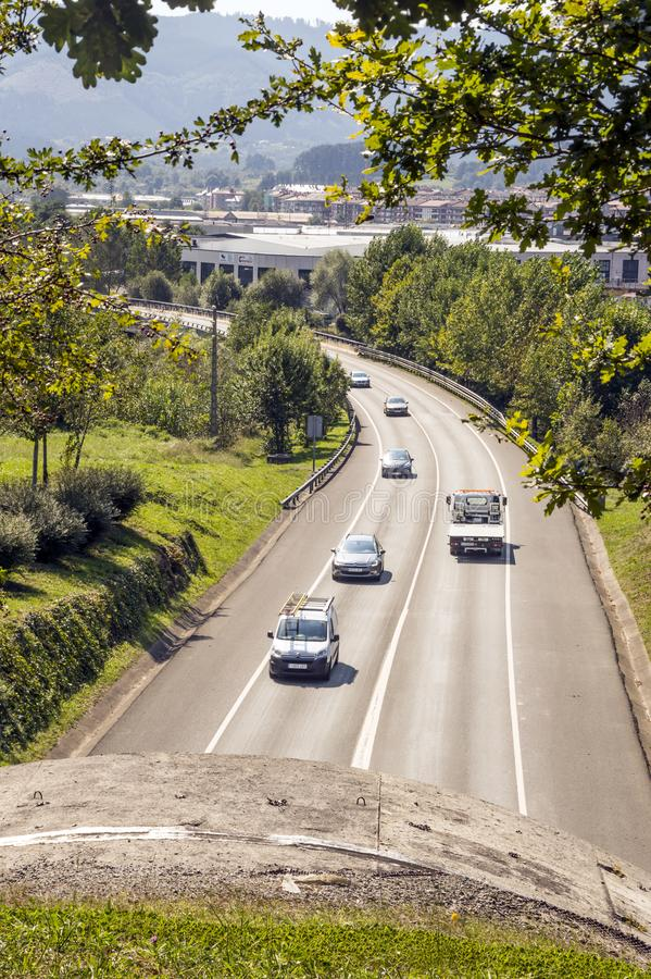 Cars on the highway. San Sebastian, Spain-September 2018. Cars on the highway surrounded by mountains in the spanish basque country on a sunny day stock photography