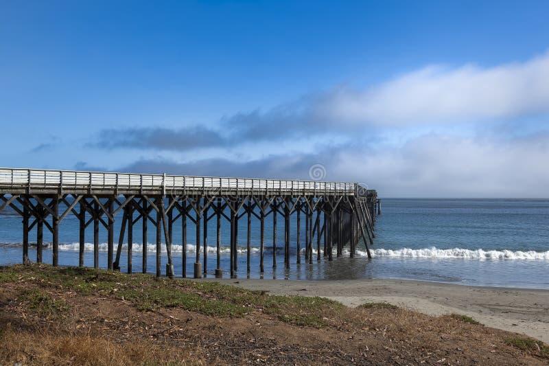 San Simoen pier in southern California. Historic San Simoen pier in San Simeon, California royalty free stock photos