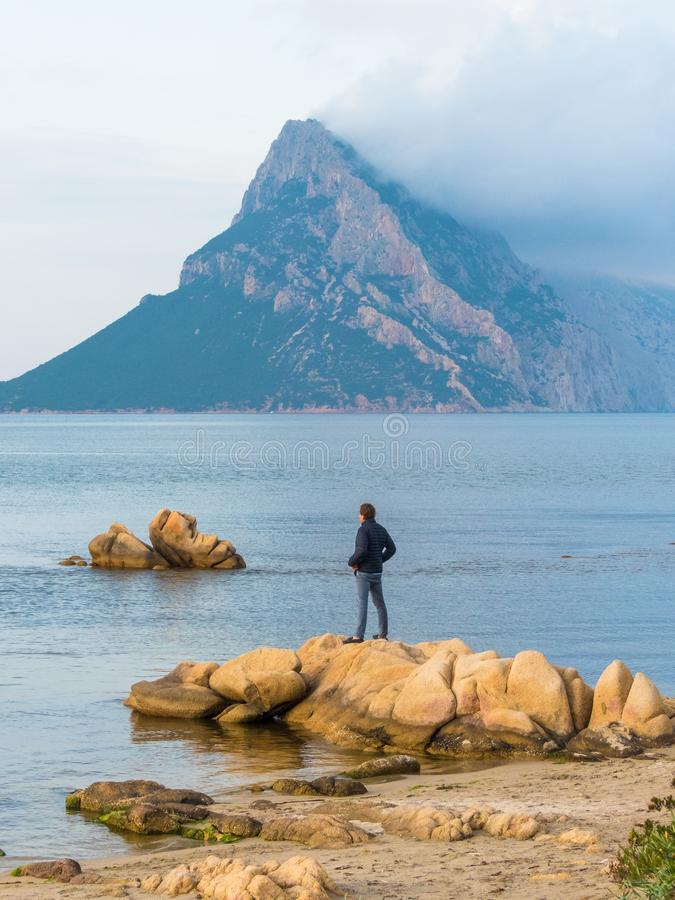 Blue water bay overlooking Isola Tavara island of Sardinia royalty free stock photo