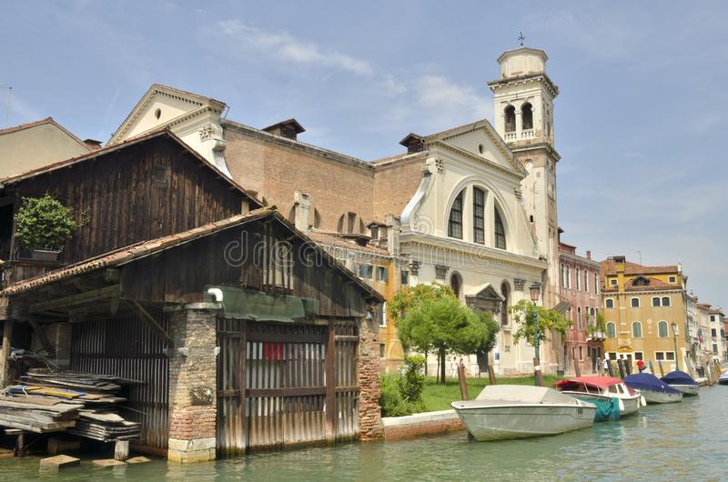 San Trovaso canal. Church and the repair yard of the gondolas in the canal of San Trovaso in the Dorsoduro district in Venice, Italy royalty free stock photography