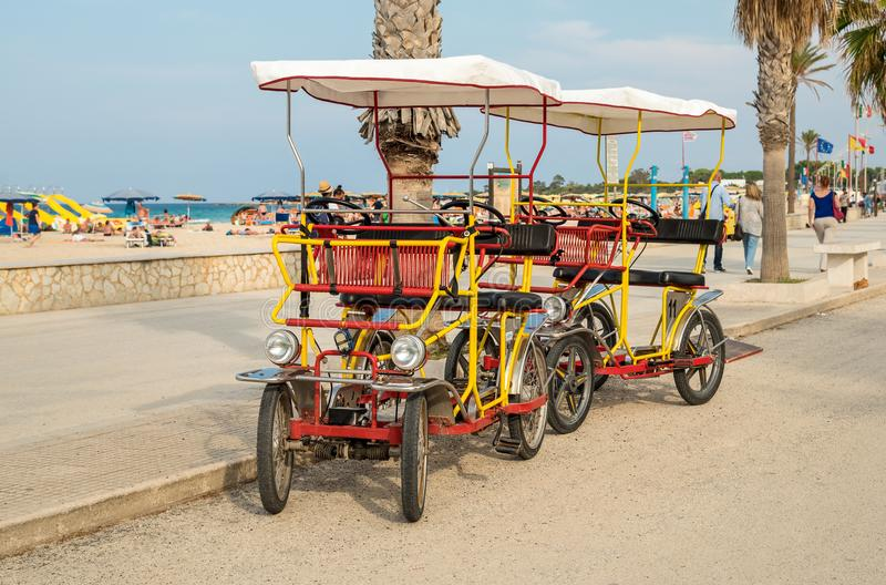 Rickshaw bicycle for rental for tourists parked near beach in San Vito Lo Capo. stock photography