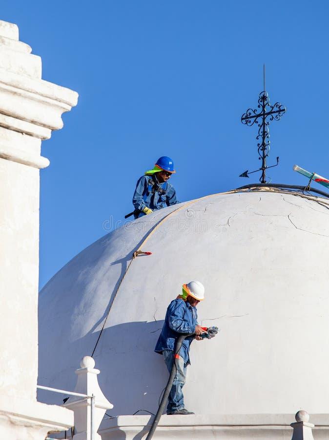 San Xavier del Bac Mission Restoration Workers foto de stock royalty free