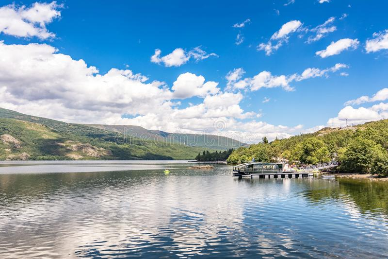 Self-sufficient boat moved with wind and solar energy without fossil fuel in the Sanabria lake in Zamora Spain. The Sanabria lake is the largest lake in Spain of royalty free stock photography