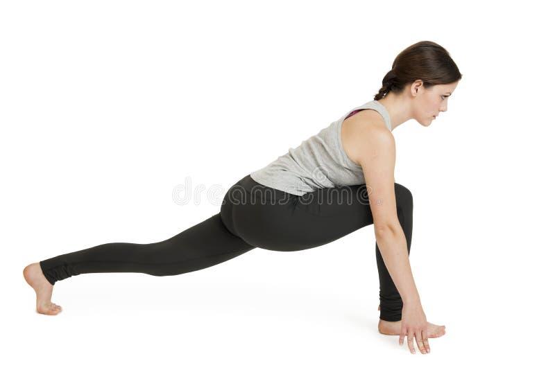 Sanchalanasana gris de position_ashva de femme de yoga photos stock