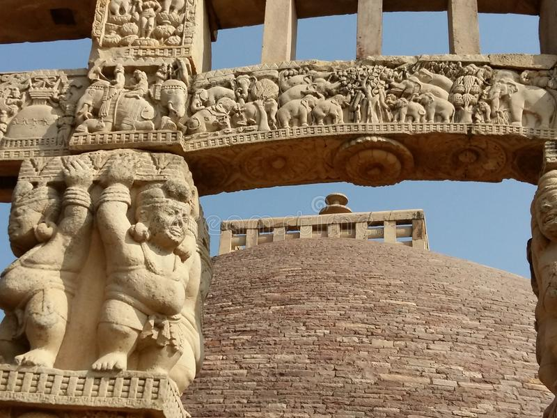 The stupa and its Gate. THE SANCHI STUPA IS NOT ONLY FAMOUS FOR THE STUPA BUT ALSO THE TALES CARVED IN THE FORM OF SCULPTURES AND MONUMENTS ENGRAVED IN THE STONE stock images