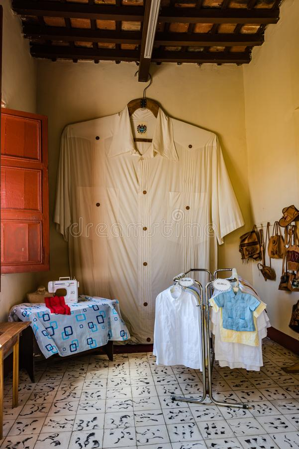 Worlds Largest Guayabera Shirt. Sancti Spiritus , Cuba / March 15, 2017: The Guayabera Museum exhibits nearly 200 of what is considered Cuba's official royalty free stock image