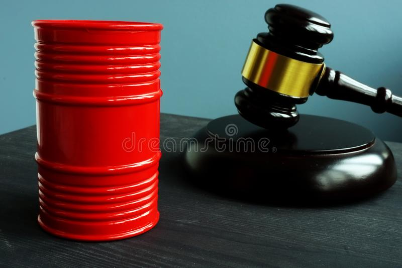 Sanction and regulation. Barrel of oil and gavel. Sanction and regulation concept. Barrel of oil and gavel royalty free stock photo