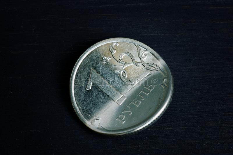 Sanctions and inflation concept. Bent Russian ruble on dark  background stock photos