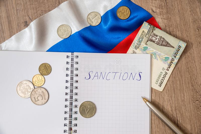Sanctions of russia. Money flag and note stock image