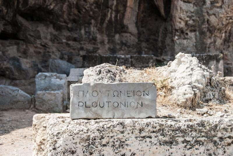 Stone inscription of Ploutonio in front of the sanctuary of Pluto Hades, god of the Underworld in Elefsina Greece stock images