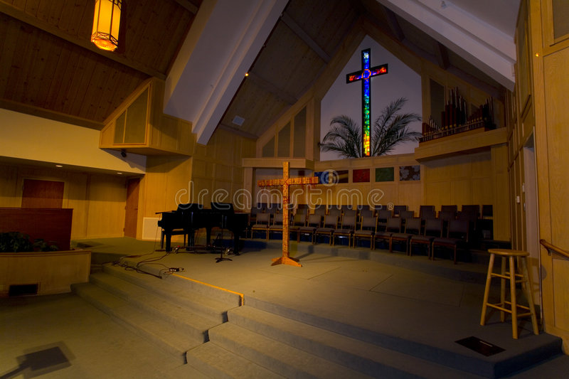 Sanctuary With A Stained Glass Cross royalty free stock photos