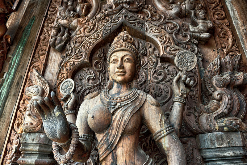Sanctuary of Truth, Pattaya. Sanctuary of Truth, is a temple construction in Pattaya, Thailand. It is an all-wood building filled with sculptures based on stock photo