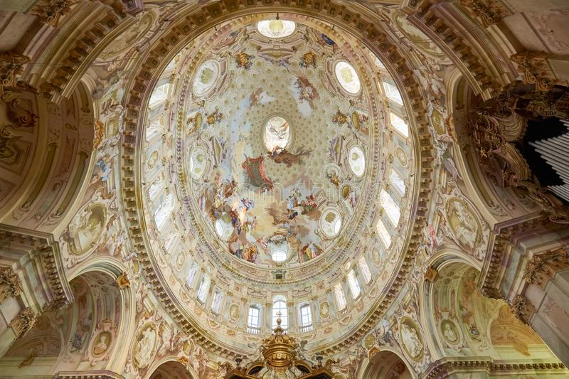Sanctuary of Vicoforte elliptical baroque dome with frescos and columns in Italy. Vicoforte, Italy - August 17, 2016: Sanctuary of Vicoforte elliptical baroque stock photo