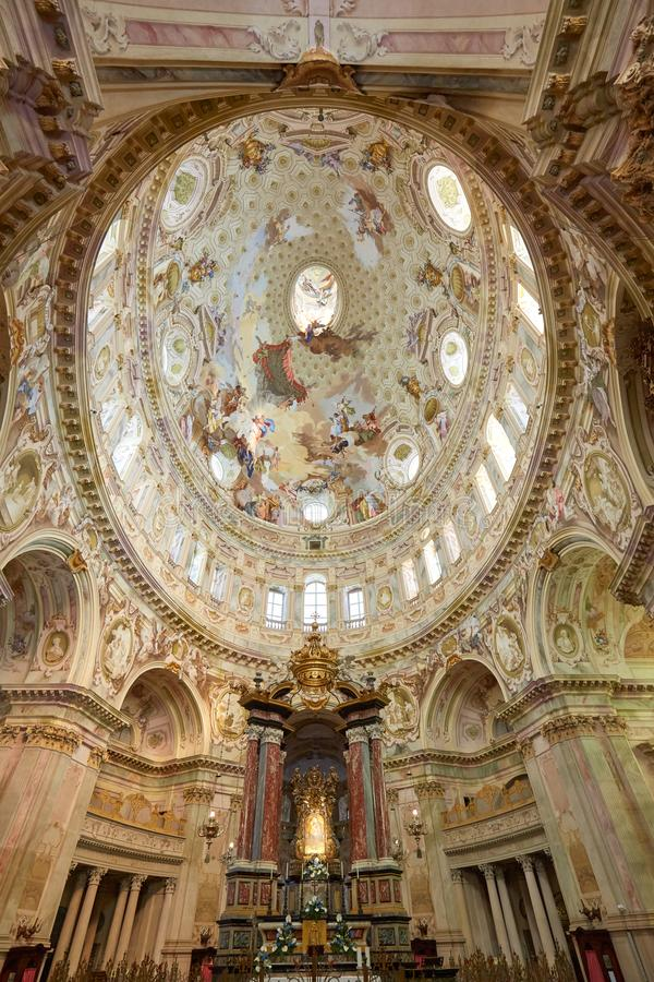 Sanctuary of Vicoforte elliptical baroque dome with frescos and Holy Mary ancient painting in Italy. Vicoforte, Italy - August 17, 2016: Sanctuary of Vicoforte royalty free stock image