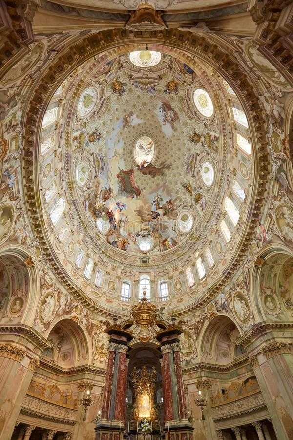 Sanctuary of Vicoforte elliptical baroque dome with frescos and Holy Mary relic painting in Piedmont, Italy. Vicoforte, Italy - August 17, 2016: Sanctuary of royalty free stock photo