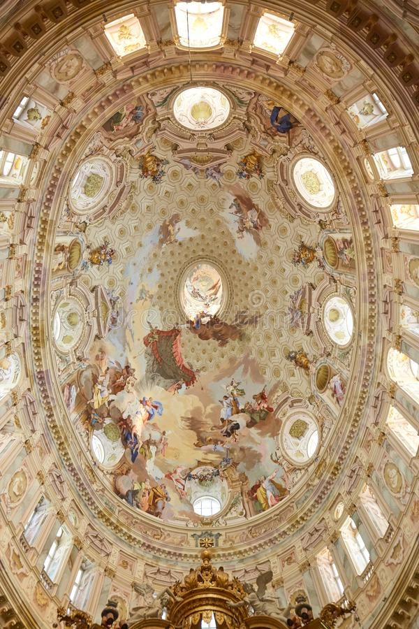 Sanctuary of Vicoforte elliptical baroque dome with frescos in Piedmont, Italy. Vicoforte, Italy - August 17, 2016: Sanctuary of Vicoforte elliptical baroque royalty free stock image