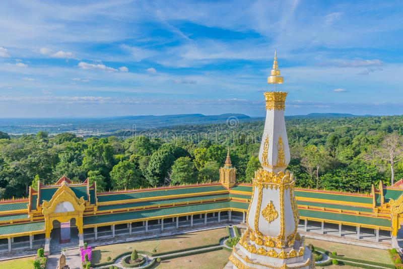 Sanctuary at Wat Phra Maha Chedi Chai Mongkol ,Roi Et province, Thailand with the beautiful sky and cloud.The public properties. The sanctuary at Wat Phra Maha royalty free stock photo