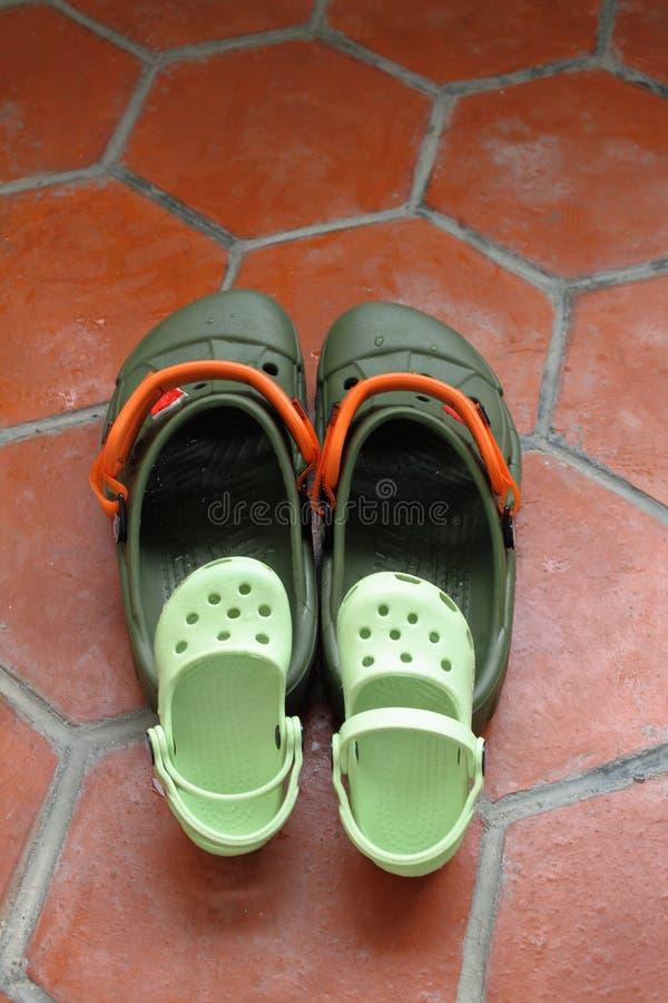 Sandálias da família fotos de stock