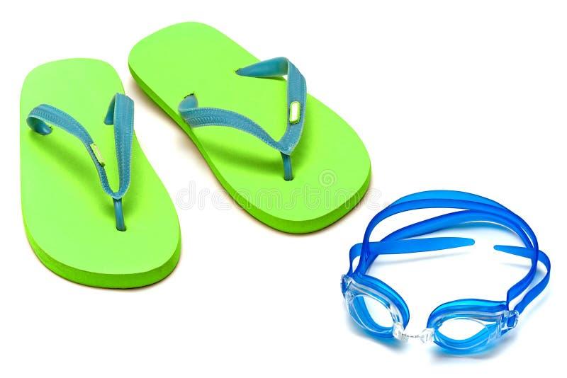 Sandálias e óculos de proteção fotografia de stock