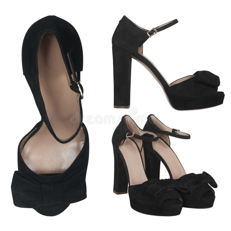 Sandálias fêmeas pretas da camurça fotos de stock