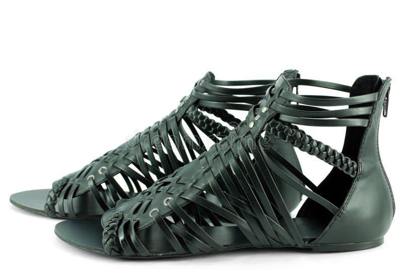 Sandálias pretas da mulher imagens de stock