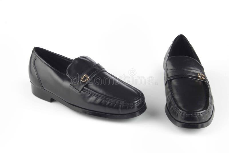 Sandálias pretas do couro da cor fotos de stock