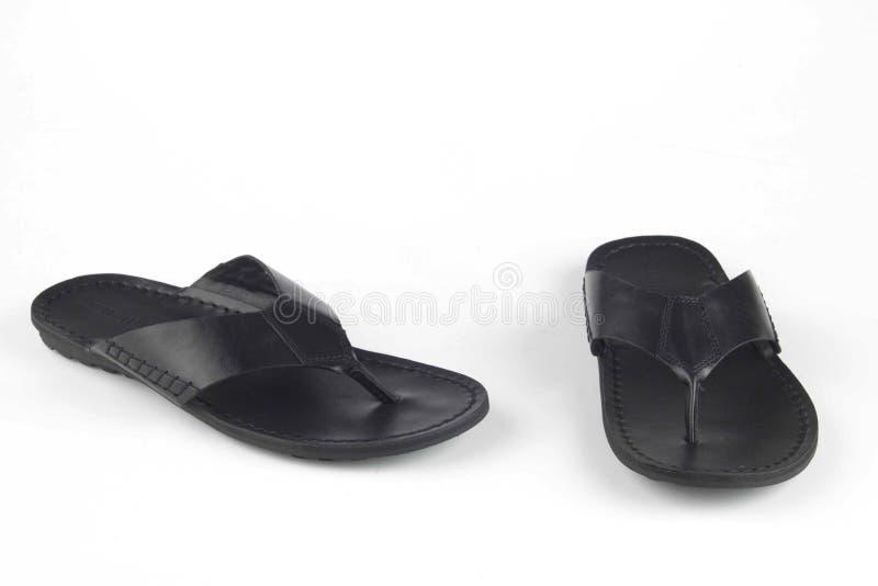 Sandálias pretas do couro da cor fotos de stock royalty free