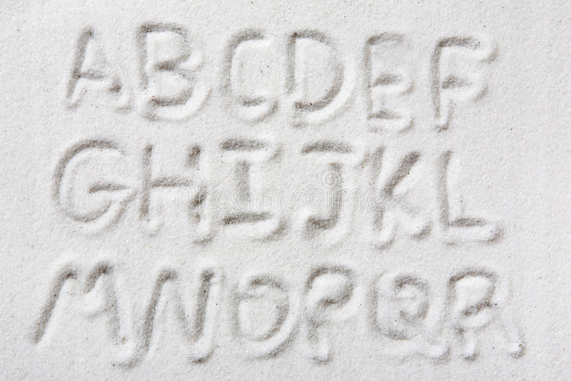 Sand-Alphabet stockfotos